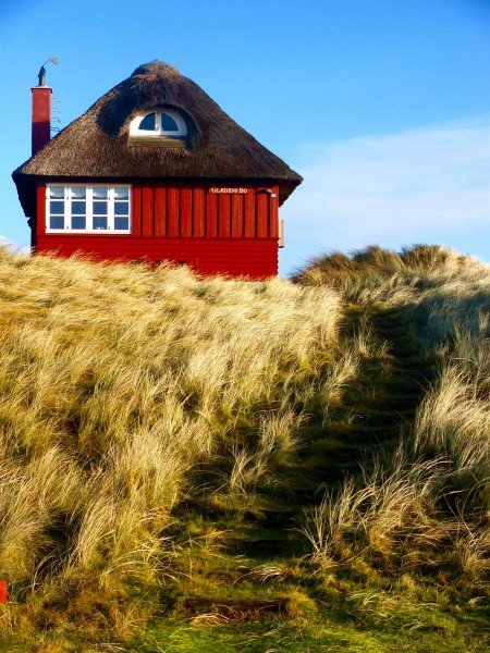 denmark-vejers-strand-winter-red-wooden-house